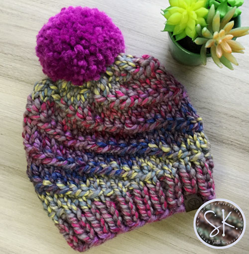 The Whirlstream Beanie, pattern by @woolandknits, in Astroland and Lollipop pom