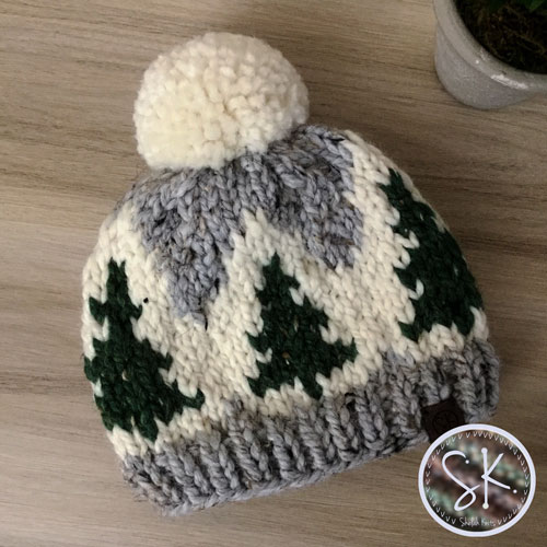 Pine Tree Parade Knit Hat, featured on photo is Baby size