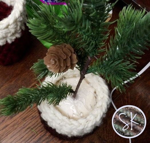 Apply more glue on the sides as necessary to secure the mini tree into the foam.