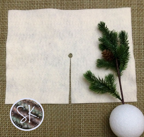 Position the greenery of your choice on the styrofoam ball by poking a small hole to the center, about 2 inches deep.